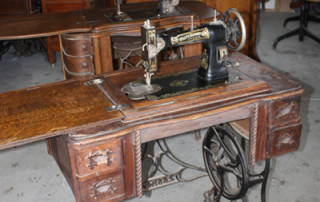 White sewing machine with manual and attachments $150