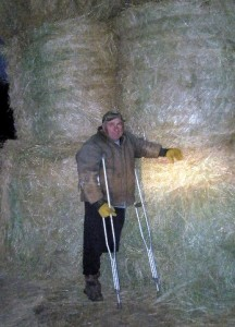 Craig stands with this years harvest of hay