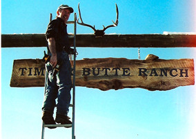 Putting up the sign at Timber Butte Ranch.