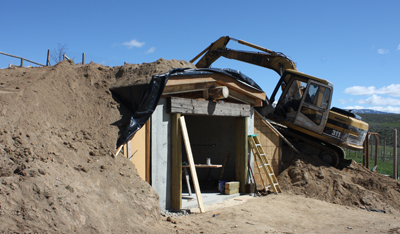 Jeff backfilled the walls and covered over the roof and the first phase of construction was complete.